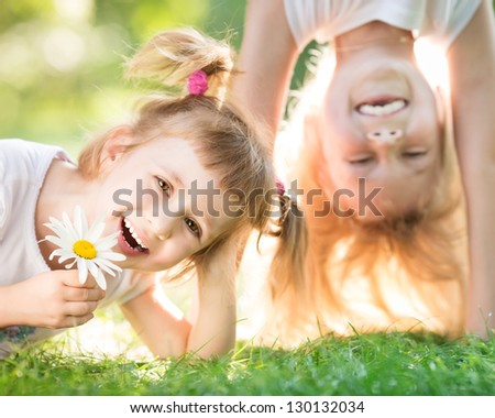 Active happy children playing outdoors in spring park - stock photo