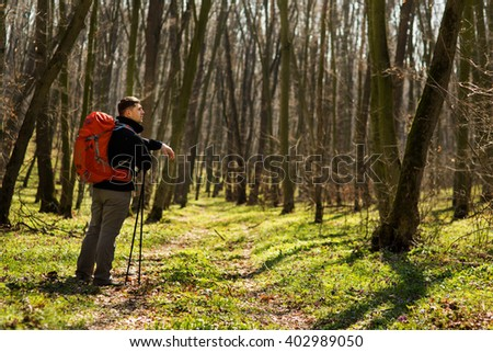 Active healthy man hiking in beautiful forest