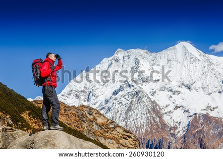Active hiker enjoying the view, looking at mountain Himalaya landscape - stock photo