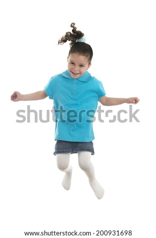 Active Joyful Young Girl Jumping with Joy Isolated on White Background