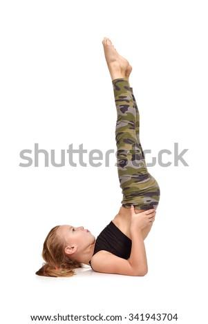 Active little girl doing yoga exercise - stock photo