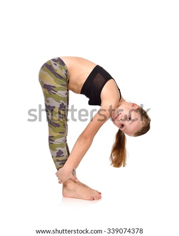 Active little girl doing yoga exercise on white background - stock photo