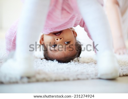 Active little girl somersaulting - stock photo