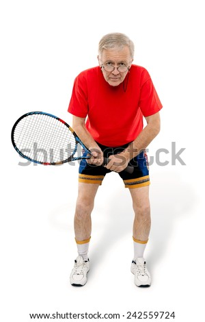 Active man waiting with tennis racquet in his hand. - stock photo