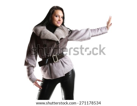 active model with a good figure in full growth, fashionable clothes, photo shoot - stock photo