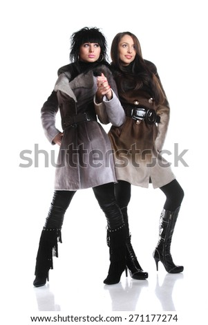 active models with a good figure in full growth, fashionable clothes, photo shoot - stock photo