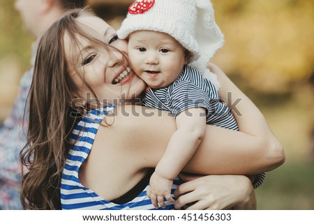 active  mother and her baby posing for photographer