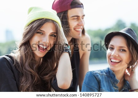 Active people. Closeup of group of happy young women and man. Outdoors, lifestyle