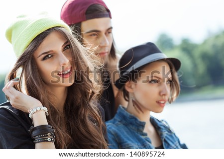 Active people. Closeup of group of young women and man. Outdoors, lifestyle - stock photo