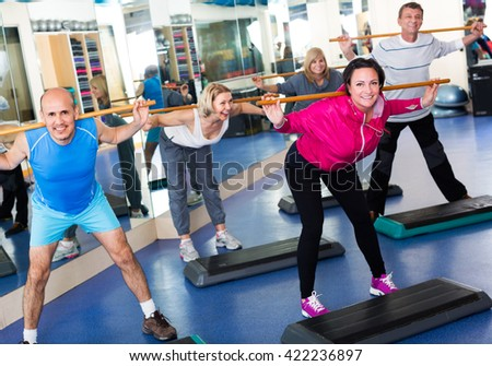 Active people do aerobics and crossfit in a sport club