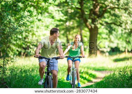 Active people on bicycles in summer - stock photo