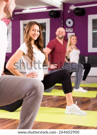 Active people training on mates at fitness school - stock photo