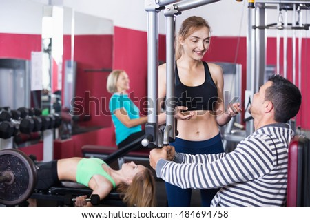 Active positive people  weightlifting training in modern health club