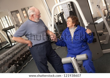 Active Senior Adult Couple Working Out Together in the Gym.