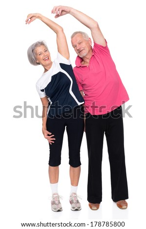 Active senior couple in front of white background - stock photo