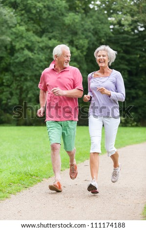 Active senior couple in the park - stock photo