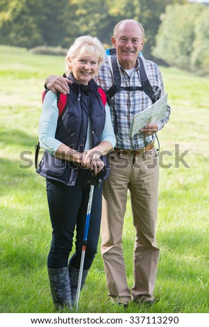 Active Senior Couple On Walk In Countryside Together - stock photo