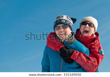 Active senior couple  - smiling mature man and woman outdoor in winter - stock photo