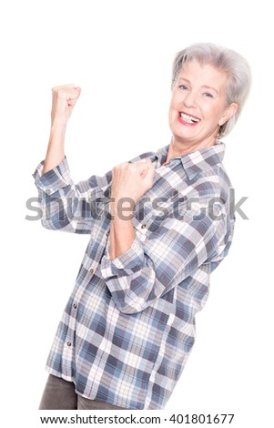 Active senior woman in front of white background