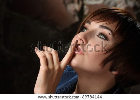 active sexual girl on a wall of stone