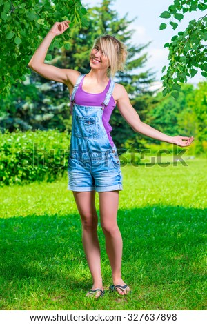 Active slim girl dancing in the park