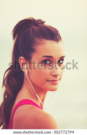 Active Sports Lifestyle with Modern Technology. Young fitness woman listening to music - stock photo