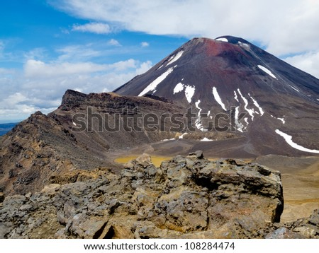 Active volcano cone of Mount Ngauruhoe as seen from Mount Tongariro in Tongariro National Park, North Island of New Zealand - stock photo