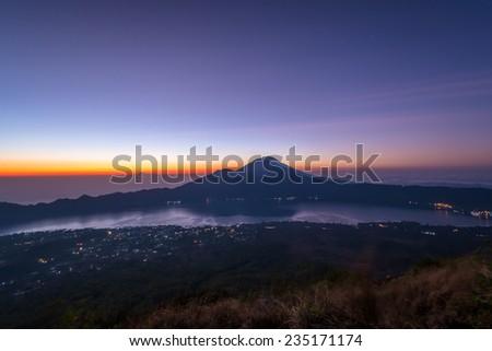 Active volcano Mount Gunung Batur at sunrise in Bali, Indonesia. - stock photo
