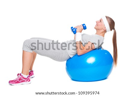 active woman doing exercises with ball and dumbbells. isolated on white background - stock photo