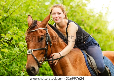 Active woman girl jockey training riding horse. Equestrian sport competition and activity. - stock photo