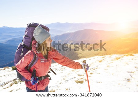 Active woman is traveling with a backpack.