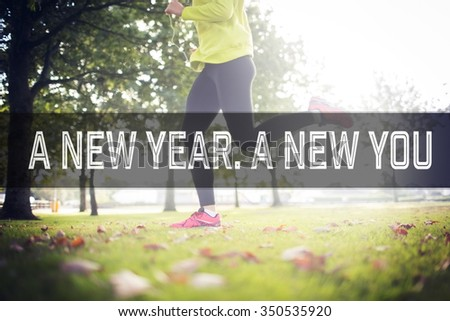Active woman jogging against motivational new years message - stock photo