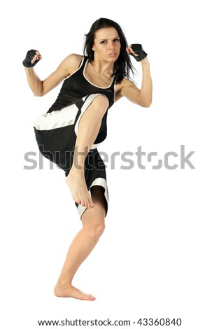 active woman kick boxer posing isolated on white background