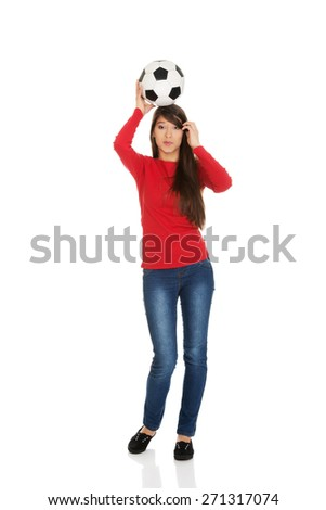 Active woman with a soccer ball on head. - stock photo
