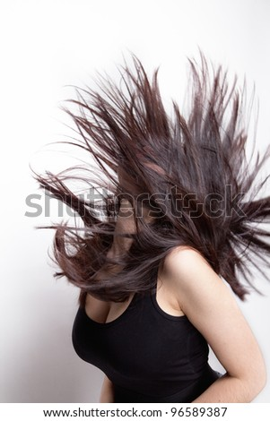 Active woman with long hair in motion