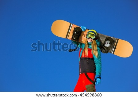 Active woman with snowboards - stock photo