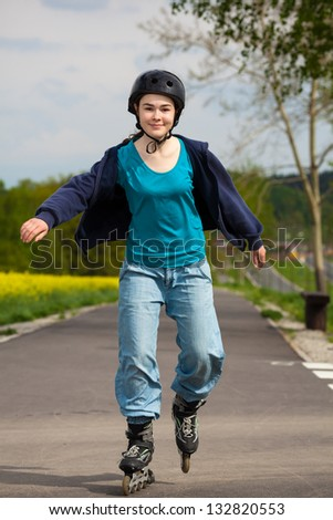 Active young people - girl rollerblading