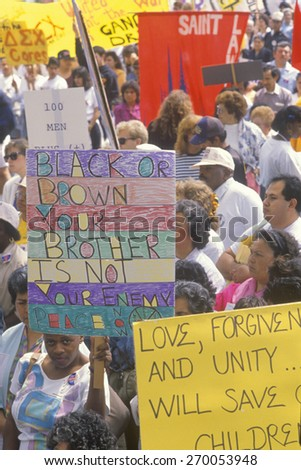 Activists holding signs during anti-violence demonstration, East Los Angeles, California - stock photo