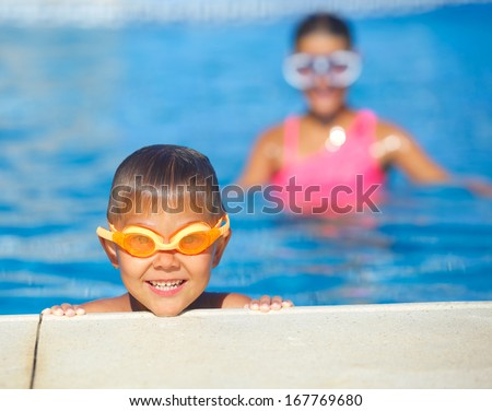 Activities on the pool. Cute boy in swimming pool - stock photo