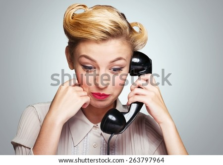 Activity. A photo of the smiling girl with vintage phone. - stock photo