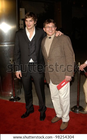 Actor ASHTON KUTCHER & father at the Los Angeles premiere of his new movie Just Married. 08JAN2003.    Paul Smith/Featureflash