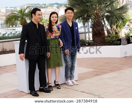 Actor Bae Sung- Woo, Actress KO Ah-Sung and Director Hong Won-Chan attend the 'O Piseu' Photocall during the 68th annual Cannes Film Festival on May 19, 2015 in Cannes, France. - stock photo