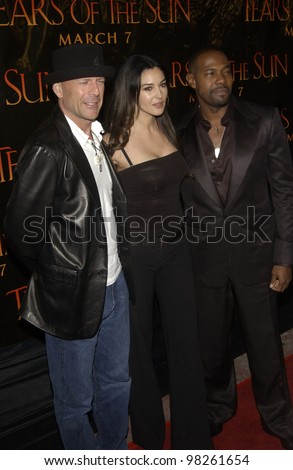 Actor BRUCE WILLIS & actress MONICA BELLUCCI & director ANTOINE FUQUA (right) at the Los Angeles premiere of their new movie Tears of the Sun. 03MAR2003.   Paul Smith / Featureflash - stock photo