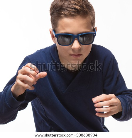 Actor brunette teenager hipster boy in sunglasses on a white background