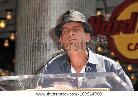 Actor Charlie Sheen on Hollywood Blvd where Slash was honored with a star on the Hollywood Walk of Fame. July 10, 2012  Los Angeles, CA Picture: Paul Smith / Featureflash - stock photo
