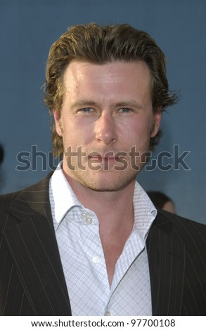 Actor DEAN McDERMOTT & wife at world premiere, in Hollywood, of Open Range. Aug 11, 2003  Paul Smith / Featureflash - stock photo