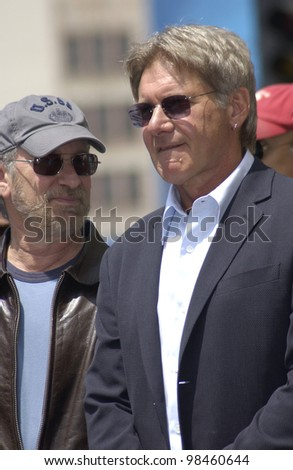 Actor HARRISON FORD & director STEVEN SPIELBERG on Hollywood Boulevard where Ford was honored with the 2,226th star on the Hollywood Walk of Fame. 30MAY2003