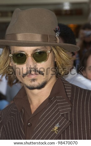 Actor JOHNNY DEPP at the world premiere of his new movie Pirates of the Caribbean: The Curse of the Black Pearl, at Disneyland, California. June 28, 2003  Paul Smith / Featureflash - stock photo