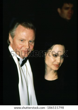 Actor JON VOIGHT with actress/daughter ANGELINA JOLIE at Vanity Fair after Academy Awards party, 03/2000 - stock photo