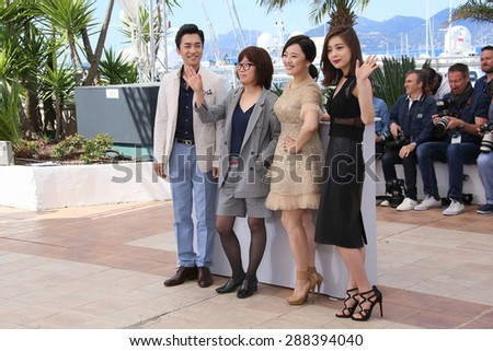 Actor Kim Young-Min, director Shin Su-Won and singer Kwon So-Hyun attend the 'Madonna' Photocall during the 68th annual Cannes Film Festival on May 20, 2015 in Cannes, France. - stock photo